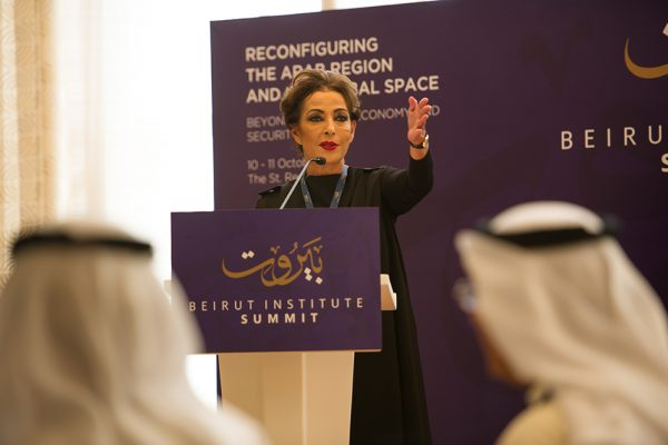 Image of lady chairing introduction to beirut institute summit event abu dhabi