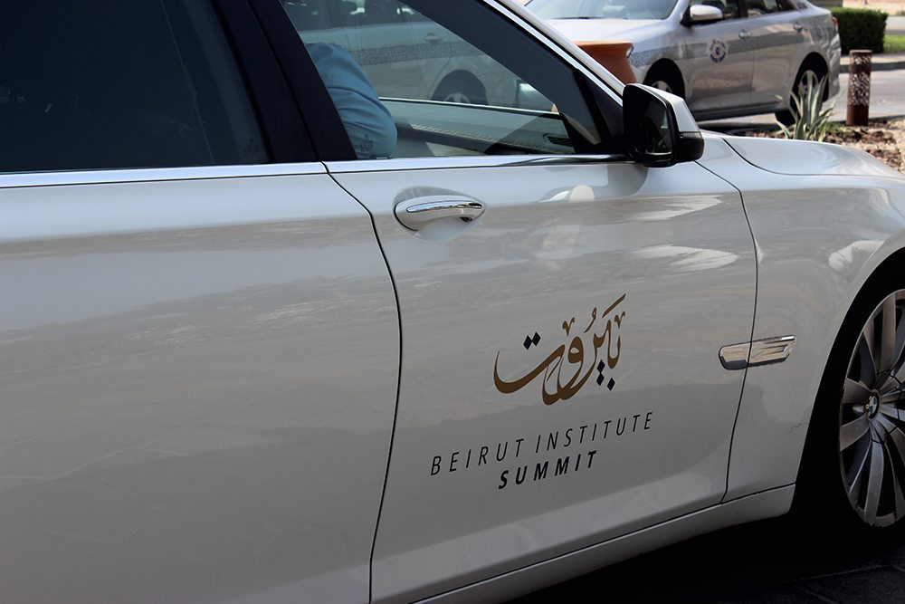 Image of branded car with logo at beirut institute summit event abu dhabi