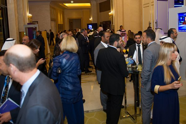 Image of attendees networking at beirut institute summit event abu dhabi