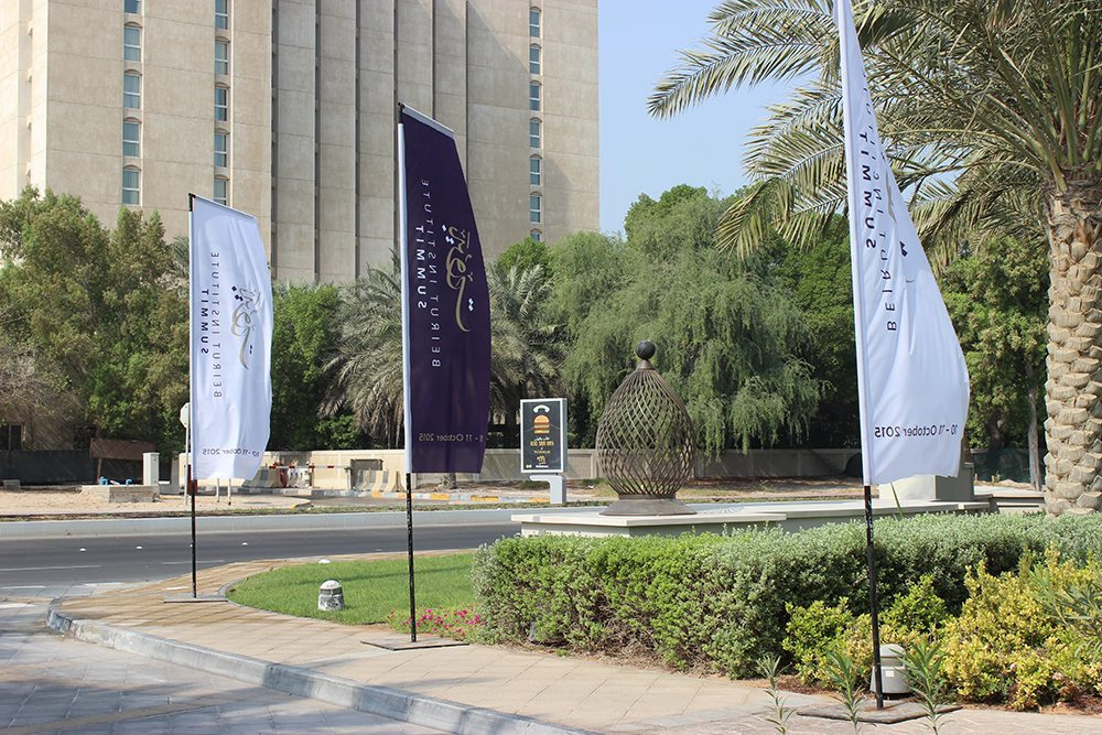 Image of branded outdoor flags at beirut institute summit event abu dhabi