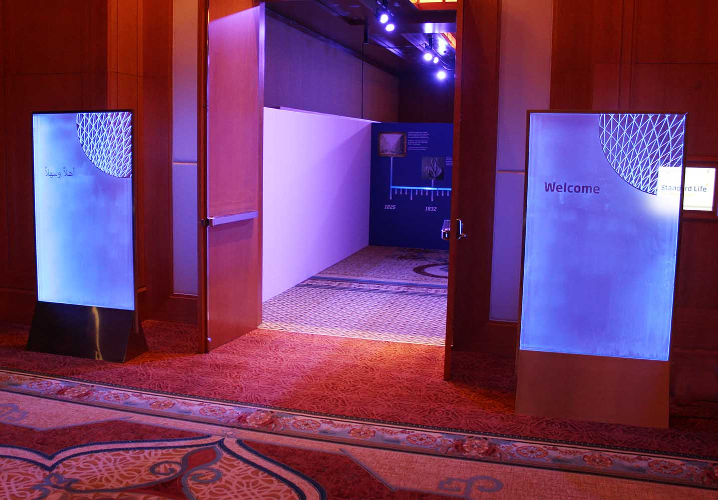 Image of frosted glass illuminated signage at brand launch event ritz carlton dubai